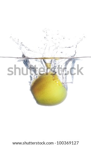green apple splash in to the water on white background