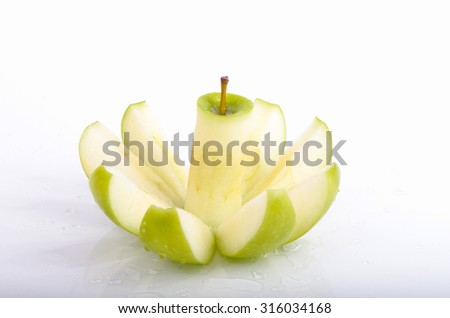 Green apple that has been sliced over white background