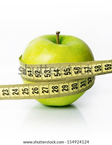 green apple with a measure tape - stock photo