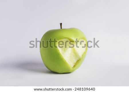 green apple with heart shape Isolated on white background - stock photo