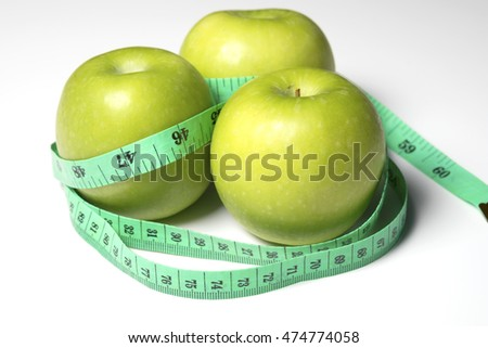 Green apple with Measure the length on white background.