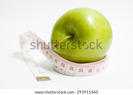 Green apple with measurement isolated on white