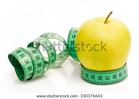 Green apple with measuring tape isolated on white background. Clipping path included
