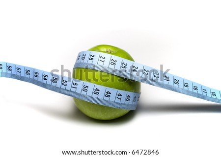 Green Apple with measuring tape on the white background