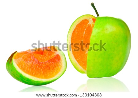 Green apple with orange content - stock photo