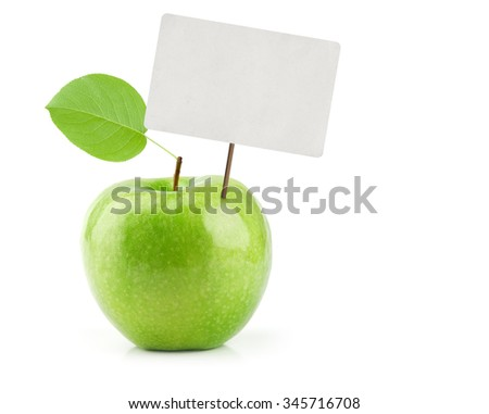 Green Apple with price tag isolated on white - stock photo