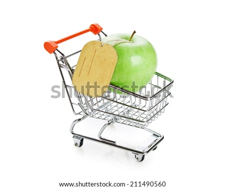 green apple with tag in shopping carts isolated on white background - stock photo