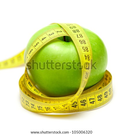 Green apple with tape - stock photo