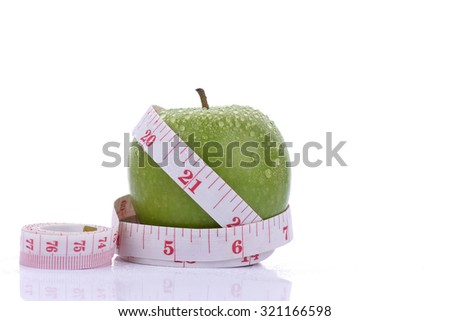 Green apple with tape on white background (health and diet concept) - stock photo