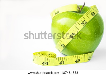 Green apple with waist and measuring tape