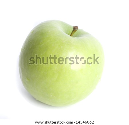 Green apple with water drops on white