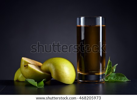 Green apples and a glass of apple juice