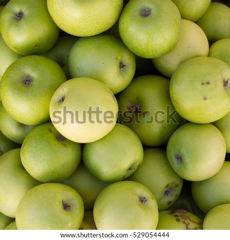 Green apples background and texture