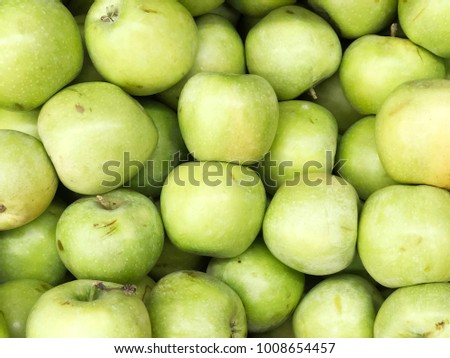 green apples harvest. green apples in packing tub at fruit warehouse.