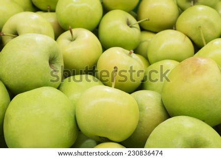 Green apples heap on shelf for sell