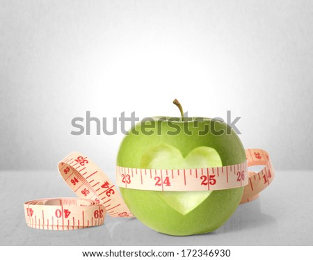Green apples measured the meter  - stock photo
