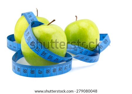 green apples measured the meter, sports apples, concept weight loss - stock photo