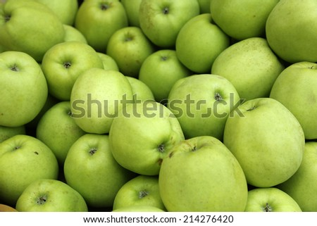 green apples on a market.