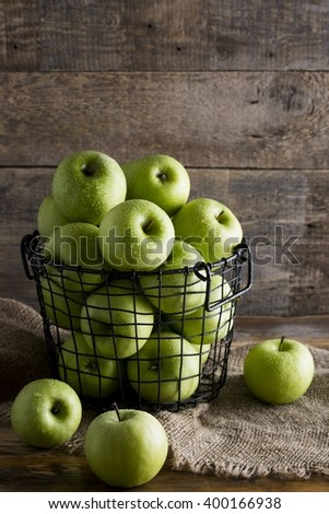 Green apples on a rustic table - stock photo