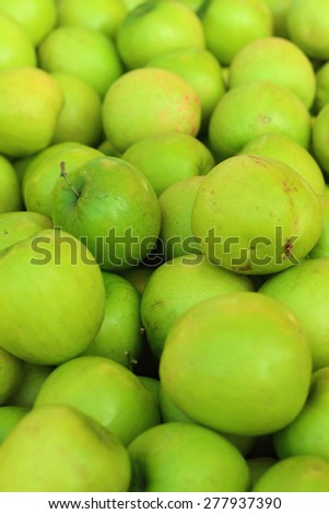 Green apples on a table at the market