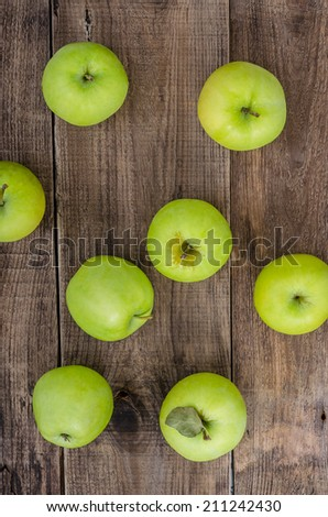 Green apples on the wooden background - stock photo
