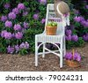 green apples on white wicker chair in garden - stock photo