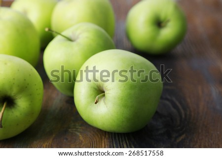 Green apples on wooden background - stock photo
