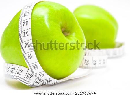 Green apples with measurement