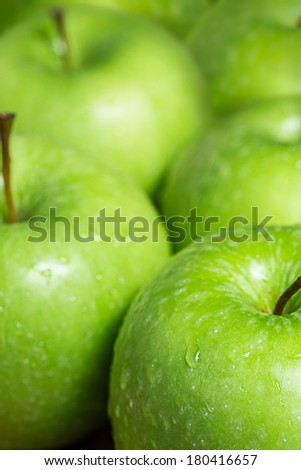 Green apples with water drops.