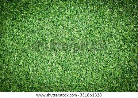 Green artificial grass soccer field - stock photo