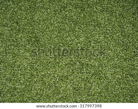 Green artificial synthetic grass meadow texture useful as a background - stock photo