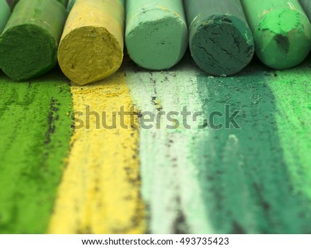 green artistic crayons
