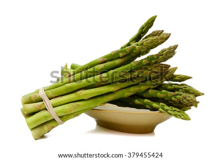 green asparagus isolated on white  - stock photo