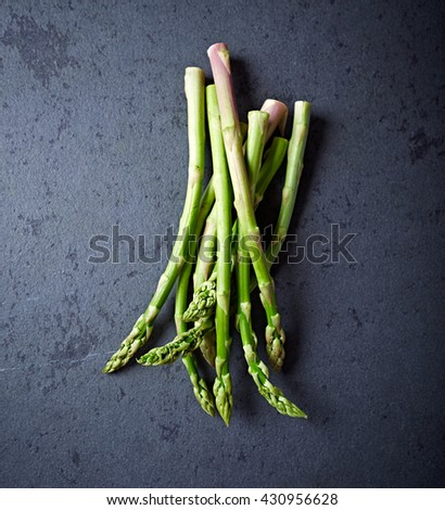 Green Asparagus on a Black Stone - stock photo