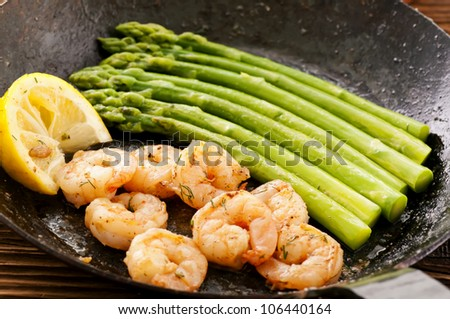green asparagus with prawns - stock photo