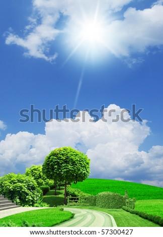 Green avenue on blue sky under the sun. - stock photo