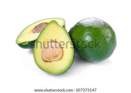 green avocados isolated on the white background