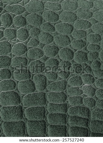 green  background based on snake skin texture - stock photo