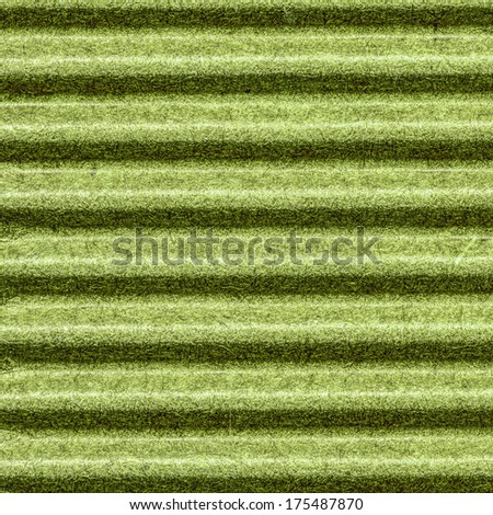 green background of corrugated paperboard closeup