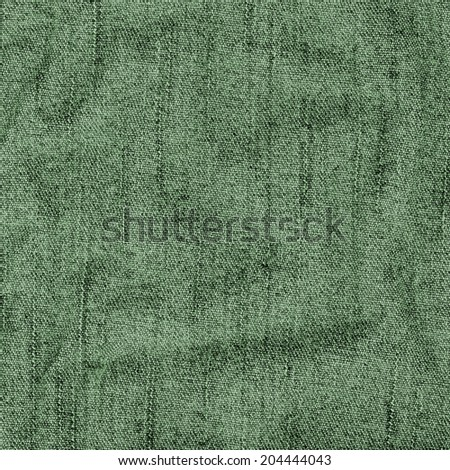green background of crumpled jeans fabric