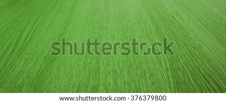 Green background panorama and texture of blurry motion, converging, abstract wood grain / lines, for design, with diminishing perspective. - stock photo