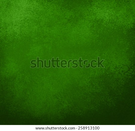 green background, vintage color and sponged distressed texture in soft blended brush strokes with darker border - stock photo
