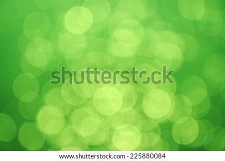 Green background with bokeh defocused lights - stock photo