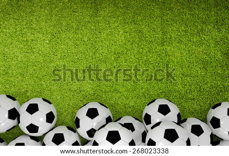 green backround with soccer balls - stock photo