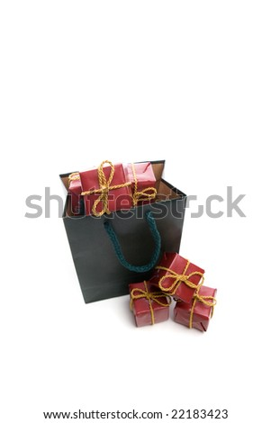green bag filled with small christmas present box isolated on white