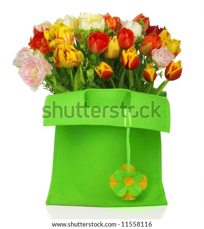 green bag with beautiful tulip bouquet and with flower deco. isolated on white background - stock photo