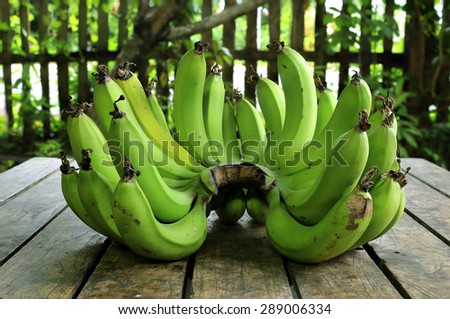 green banana on background wood - stock photo
