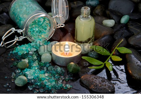 Green bath salt and massage oil - stock photo