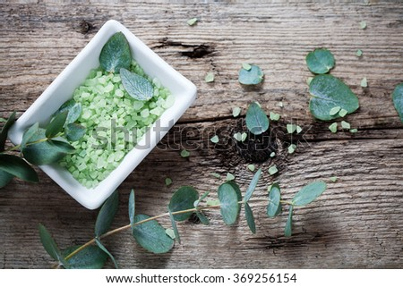 Green bath salt with fresh eucalyptus leaves - stock photo