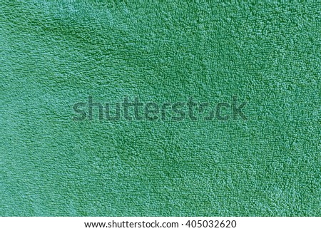 Green bath towel texture. Background and texture for design. - stock photo